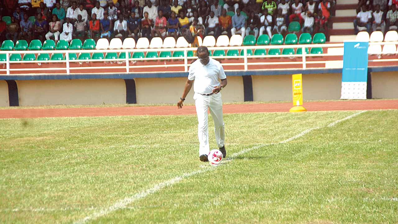 Governor Ifeanyi Okowa kicks off the football match at the commissioning of Delta State Polytechnic, Ozoro's Olympic-size stadium at the Isoko North local government area headquarters.