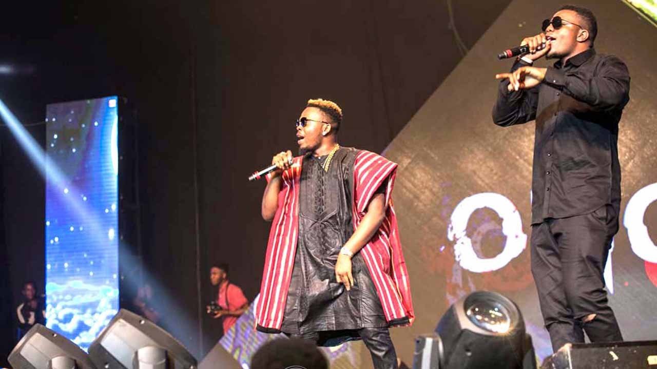 Olamide (left) performing at the concert.