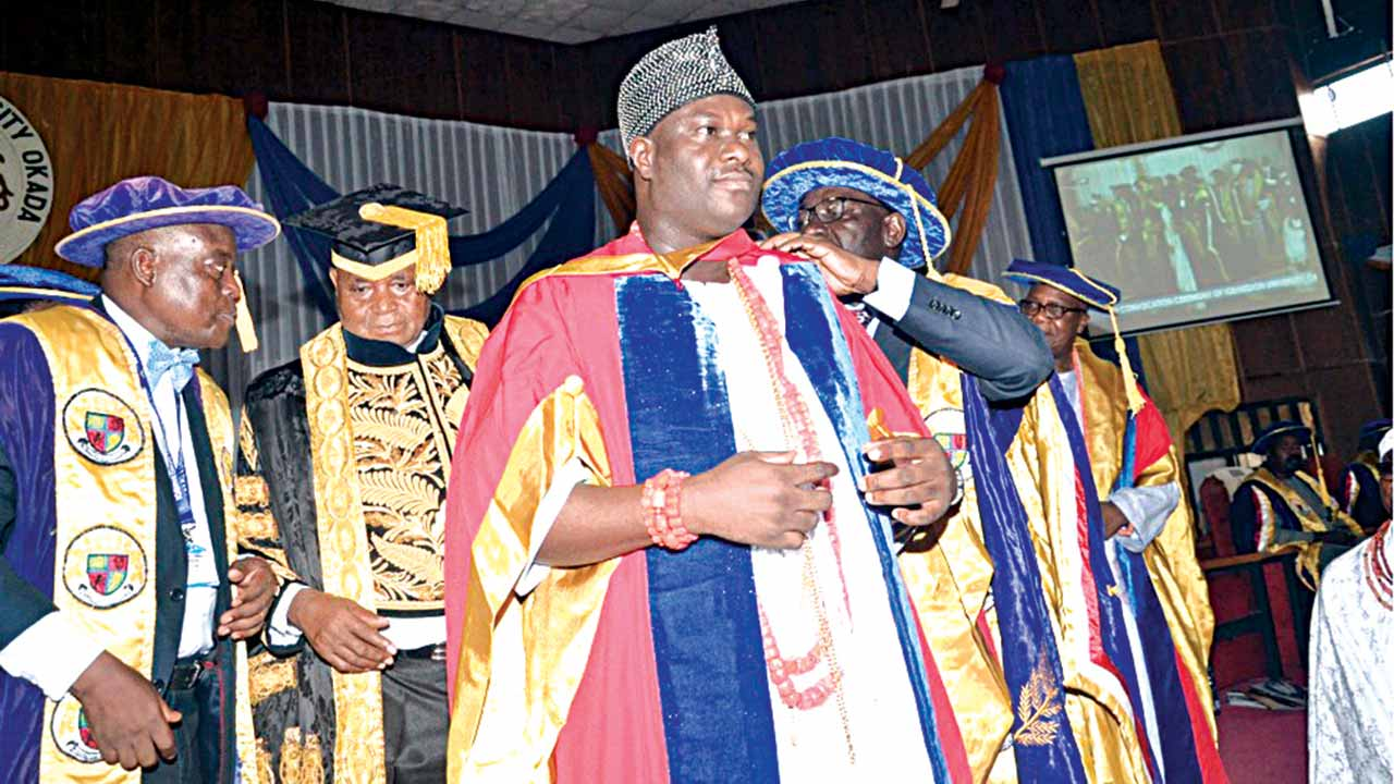 Vice Chancellor, Igbinedion University, Okada, Edo State, Rev. Prof. Eghosa Osaghae (left); Chancellor of the institution, Gabriel Igbinedion; and Ooni of Ife, Oba Adeyeye Enitan Ogunwusi (Ojaja II) being decorated by the governor of the state, Mr. Godwin Obaseki, at the 14th convocation of the institution... recently