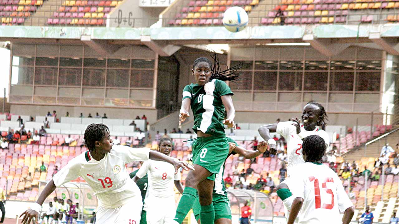 Nigeria's striker, Asisat Oshoala, out jumps her Senegalese opponents to head the ball during one of the qualifying matches for the just concluded African Women Nations Cup hosted by Cameroun