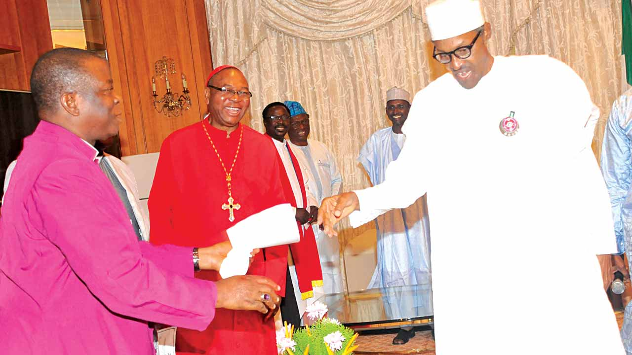 President Muhammadu Buhari (right); Catholic Archbishop of Abuja, John Cardinal Onaiyekan and Primate, Church of Nigeria (Anglican Communion), Nicholas Okoh, during a Christmas visit by community leaders in the Federal Capital Territory (FCT) to the President at the Presidential Villa, Abuja… yesterday. PHOTO: PHILIP OJISUA