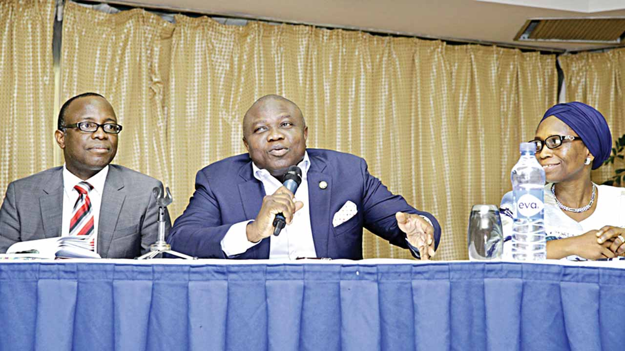 Lagos State Governor, Akinwunmi Ambode (middle), flanked by Commissioner for Finance/Economic Planning and Budget, Adeyemi Ashade (left) and Permanent Secretary/Accountant General, Mrs. Abimbola Umar during the governor's meeting with investors on Bond Issuance in Abuja… yesterday