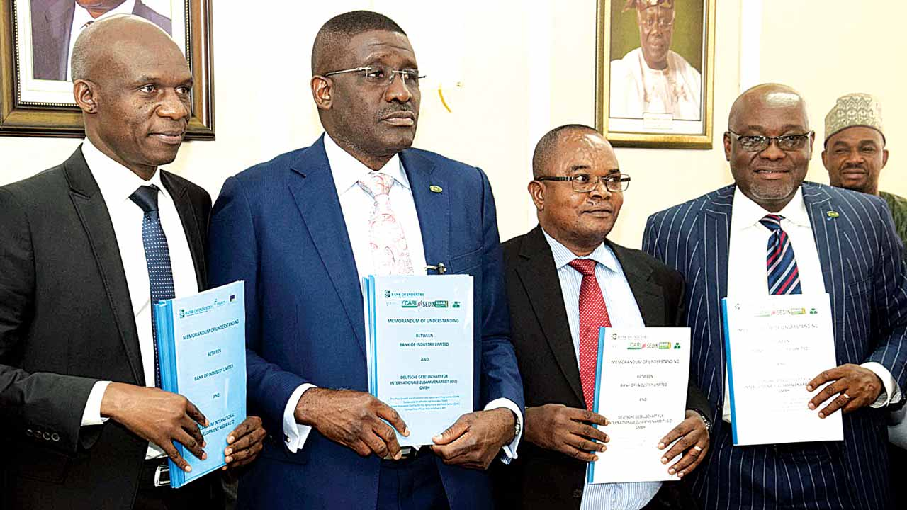 Team Leader, Propcom, Collins Apuoyo (left), Acting Managing Director, Bank of Industry (BoI), Waheed Olagunju, Country Coordinator, Competitive African Rice Initiative (CARI), Deutsche Gesellschaft Fur Internationale Zusammenarbeit (GIZ), Dr. Andrew Efisue, and Executive Director (Corporate Services) BoI, Tobin Jonathan, at the signing of Memorandum of Understanding (MoU) of AGRO Mechanisation Fund, in Abuja…yesterday