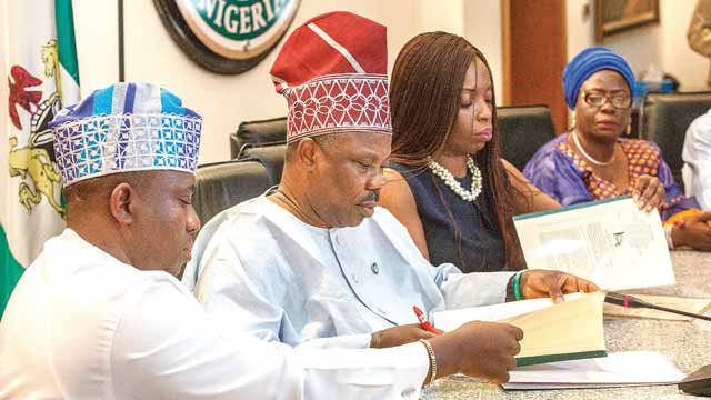Speaker, Ogun State House of Assembly, Suraj Ishola Adekunbi (left); Governor Ibikunle Amosun; Commissioner for Budget and Planning, Adenrele Adeshina and Deputy Governor, Yetunde Onanuga; during the signing of the 2017 Appropriation Bill into law by the governor… yesterday.