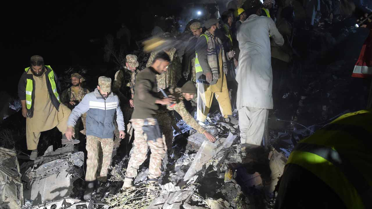 Pakistani soldiers and volunteers search for victims from the wreckage of the crashed PIA passenger plane Flight PK661 at the site in the village of Saddha Batolni in the Abbottabad district of Khyber Pakhtunkhwa province on December 7, 2016. A Pakistani plane carrying 48 people crashed on December 7, in the country's mountainous north and burst into flames killing everyone on board, authorities said, in one of the deadliest aviation accidents in the country's history. Pakistan International Airlines Flight PK661 came down while travelling from the city of Chitral to Islamabad, the civil aviation authority said. AAMIR QURESHI / AFP
