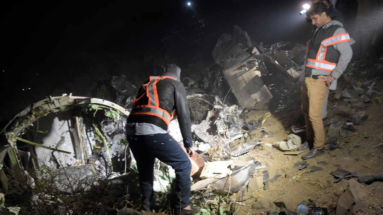 "Pakistani officials of Pakistan International Airlines (PIA) looks at the wreckage of the crashed PIA passenger plane Flight PK661 at the site in the village of Saddha Batolni in the Abbottabad district of Khyber Pakhtunkhwa province on December 7, 2016. All 48 people on board a Pakistani plane which crashed in the country's mountainous north and burst into flames have died, officials told AFP on December 7, 2016. ""No one survived,"" said the Civil Aviation Authority spokesman. AAMIR QURESHI / AFP"