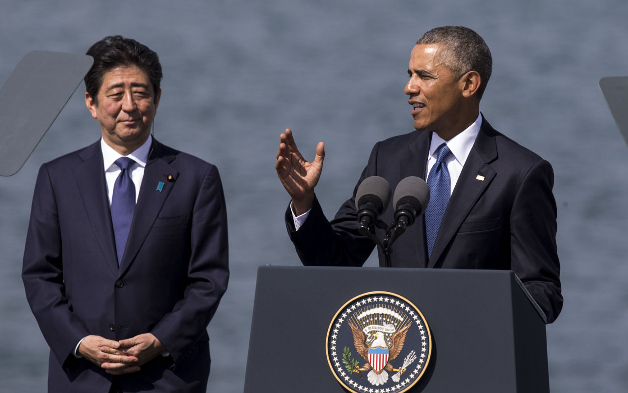 HONOLULU, HI - DECEMBER 27: U.S. President Barack Obama delivers remarks while Japanese Prime Minister Shinzo Abe listens at Joint Base Pearl Harbor Hickam's Kilo Pier on December 27, 2016 in Honolulu, Hawaii. Abe is the first Japanese prime minister to visit Pearl Harbor with a U.S. president and the first to visit the USS Arizona Memorial. Kent Nishimura/Getty Images/AFP