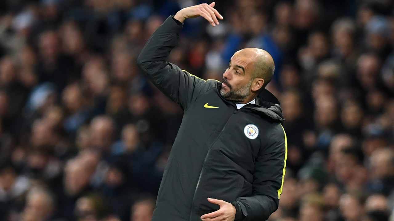 Manchester City's Spanish manager Pep Guardiola gestures on the touchline during the English Premier League football match between Manchester City and Arsenal at the Etihad Stadium in Manchester, north west England, on December 18, 2016. Paul ELLIS / AFP
