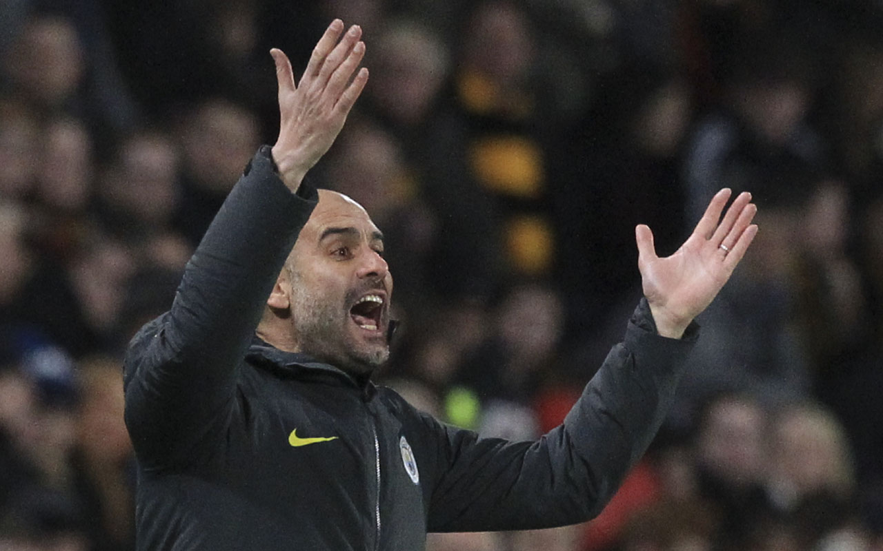 Manchester City's Spanish manager Pep Guardiola gestures from the touchline during the English Premier League football match between Hull City and Manchester City at the KCOM Stadium in Kingston upon Hull, north east England on December 26, 2016. / AFP PHOTO / Lindsey PARNABY /