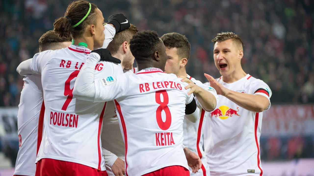 Players of RB Leipzig celebrate scoring during the German first division Bundesliga football match between RB Leipzig and Schalke 04 in Leipzig, eastern Germany on December 3, 2016. JENS SCHLUTER / AFP