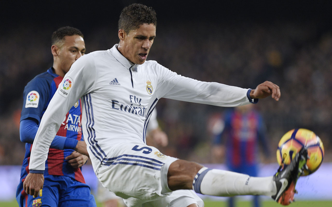 Real Madrid's French defender Raphael Varane controls the ball during the Spanish league football match FC Barcelona vs Real Madrid CF at the Camp Nou stadium in Barcelona on December 3, 2016. / AFP PHOTO / LLUIS GENE