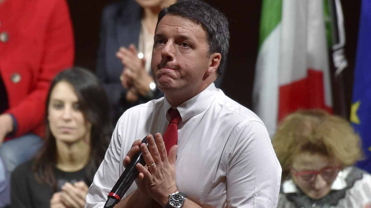 "talian Prime Minister Matteo Renzi addresses supporters during a ""Basta un Si"" rally calling for a ""Yes"" vote to the upcoming constitutional reform referendum at the Fuksas' Cloud Convention Centre in central Rome on November 26, 2016. Italy will hold a referendum on constitutional reform on December 4 in which Renzi has staked his political future on winning approval of a move to streamline parliament by replacing the Senate with a smaller, less powerful second chamber. ANDREAS SOLARO / AFP"