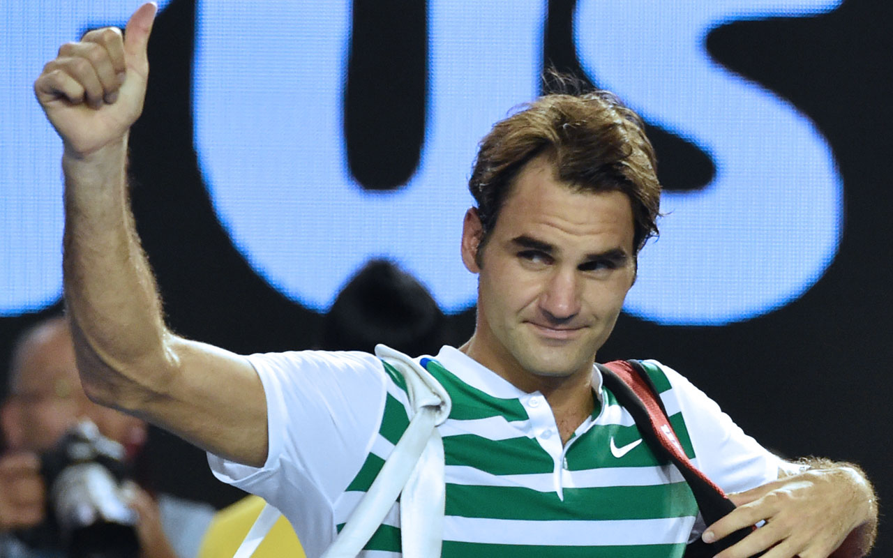 (FILES) This file photo taken on January 28, 2016 shows Switzerland's Roger Federer gesturing as he leaves the court during his men's singles semi-final match against Serbia's Novak Djokovic at the 2016 Australian Open tennis tournament in Melbourne. Federer makes his long-awaited return to tennis after six months out with a knee injury in the mixed teams Hopman Cup in Perth on January 1, 2017 ahead of next month's Australian Open. / AFP PHOTO / Saeed KHAN /