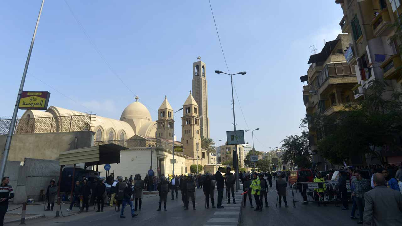 Egyptian security forces gather at the site of an explosion at the Saint Mark's Coptic Orthodox Cathedral on December 11, 2016 in the Abbasiya neighbourhood in the capital Cairo. Copts, who make up about 10 percent of Egypt's population of 90 million, have faced persecution and discrimination that spiked during the 30-year rule of Hosni Mubarak, who was toppled by a popular uprising in 2011. KHALED DESOUKI / AFP