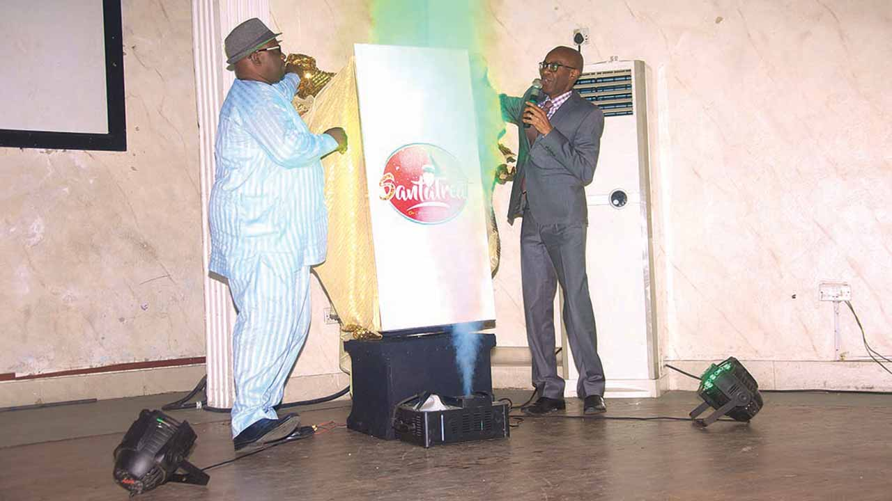 President, National Association of Theatre Arts Practitioners, Mr. Tunde Obalana and the Managing Director, Lucent Consulting Nigeria Ltd, Lampe Omoyele unveiling the SantaTreat logo… in Lagos