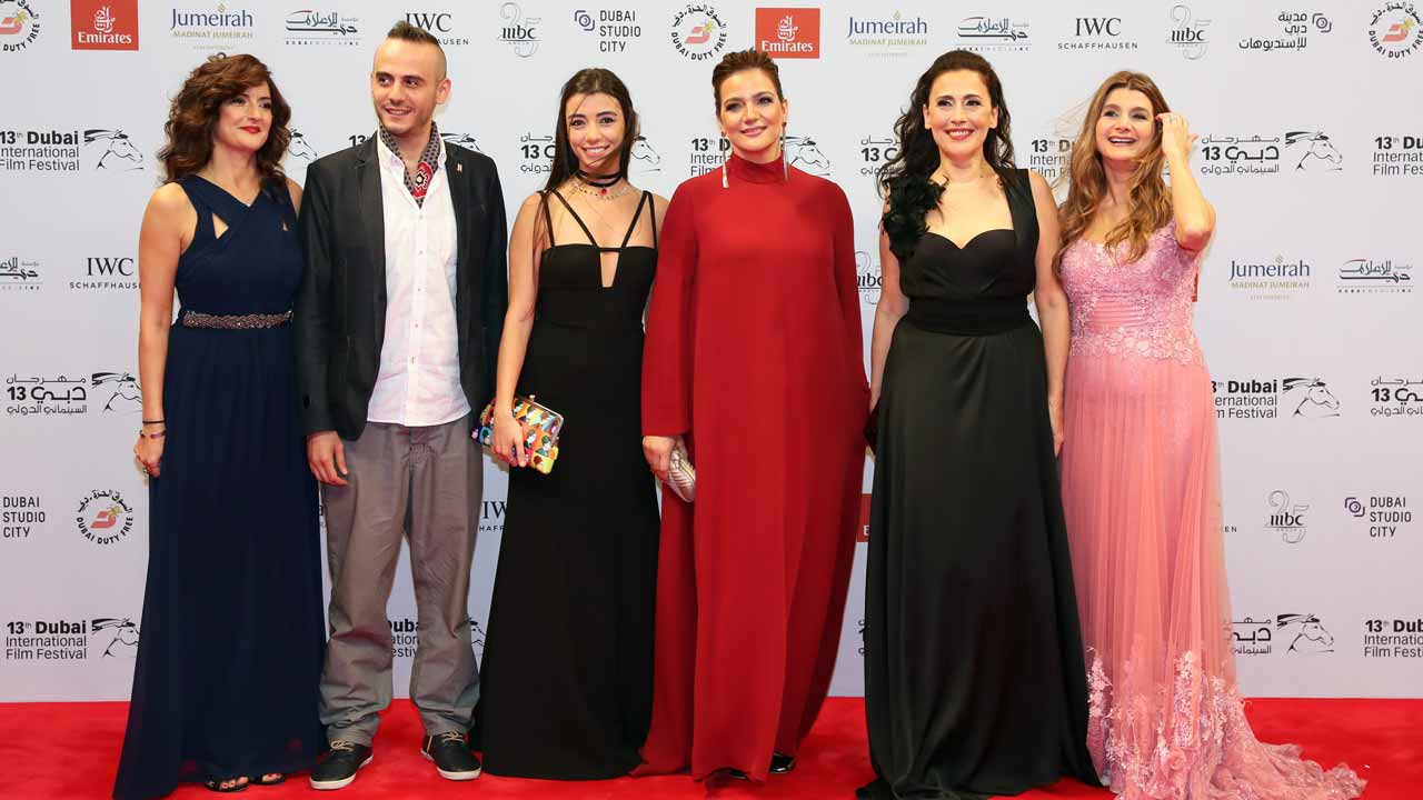 "(L to R) Actors Nicole Kamato, Jaber Jokhadar, Serena Chami, director Sophie Boutros and actresses Julia Kassar, and Betty Taoutel pose upon their arrival for the screening of their movie ""Solitaire"" during 13th Dubai International Film Festival (DIFF), on December 11, 2016. KARIM SAHIB / AFP"