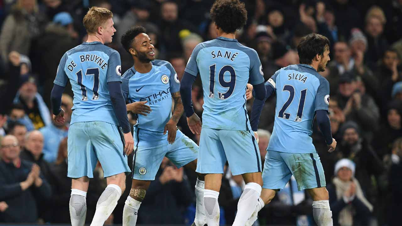 Manchester City's English midfielder Raheem Sterling (2nd L) celebrates with teammates after scoring their second goal during the English Premier League football match between Manchester City and Arsenal at the Etihad Stadium in Manchester, north west England, on December 18, 2016. Paul ELLIS / AFP