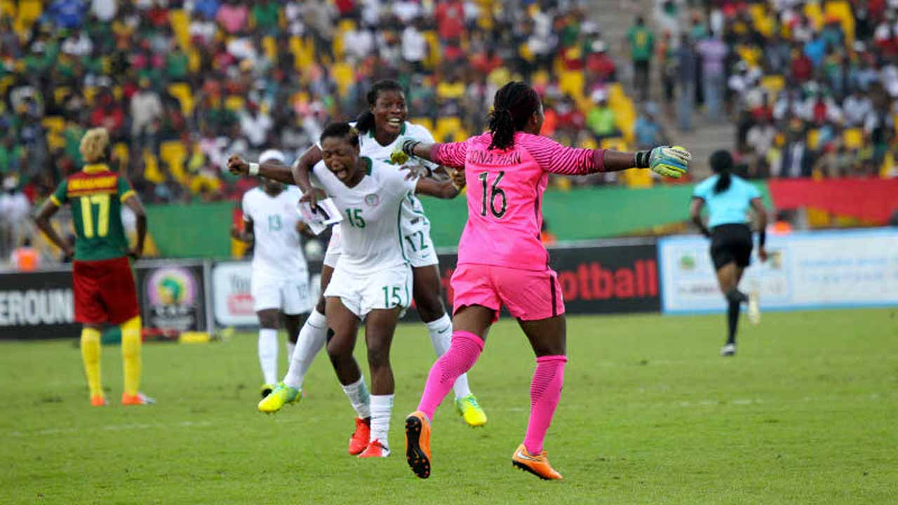Super Falcons goalkeeper, Jonathan celebrates with her teammate after beating Cameroon 1-0, at the final of African Women Cup of Nation, (AWCON) in Yaounde, Cameroon, yesterday. PHOTO: CAF