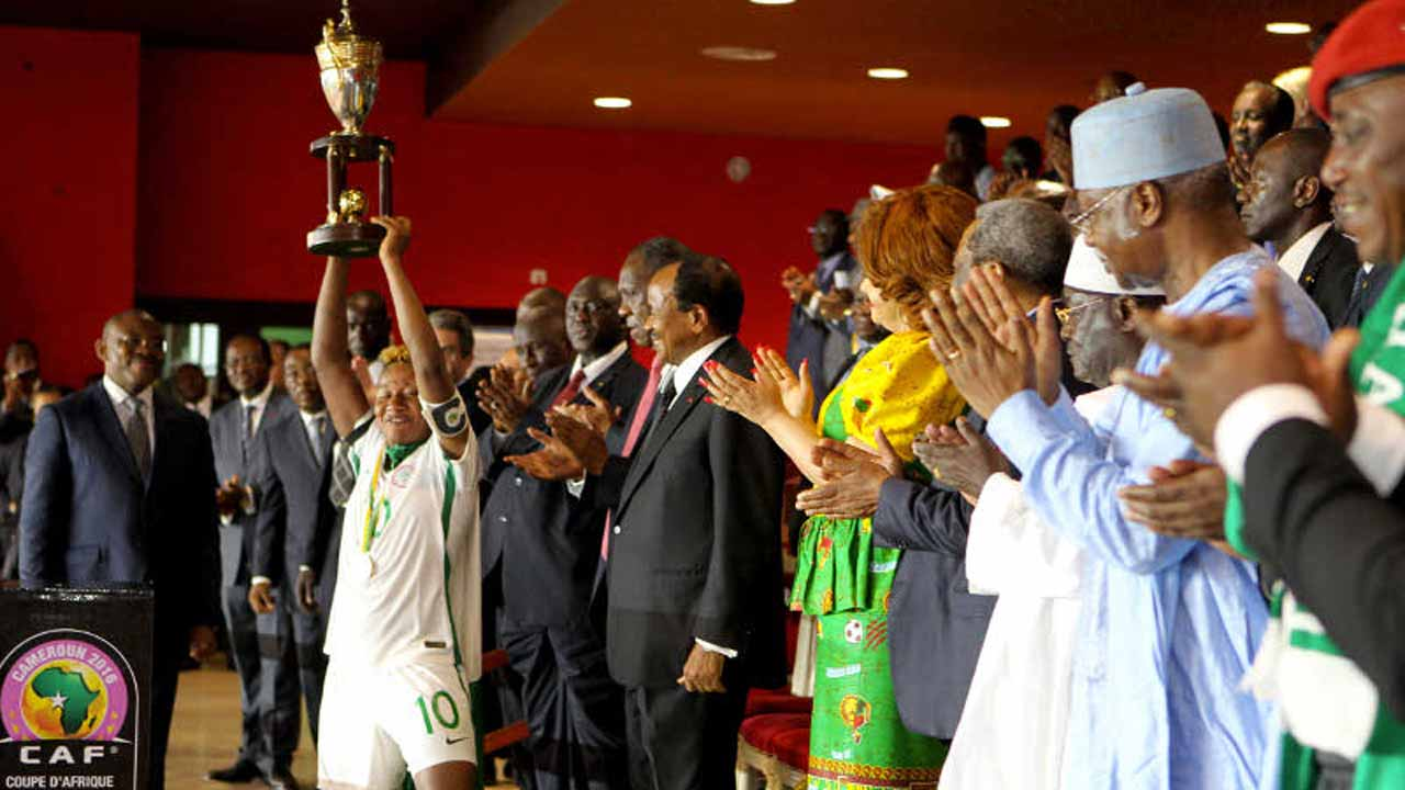 Nigeria's Super Falcons' Captain lifted the AWCON Cup after beaten Cameroon in the final of the tournament. PHOTO: CAF