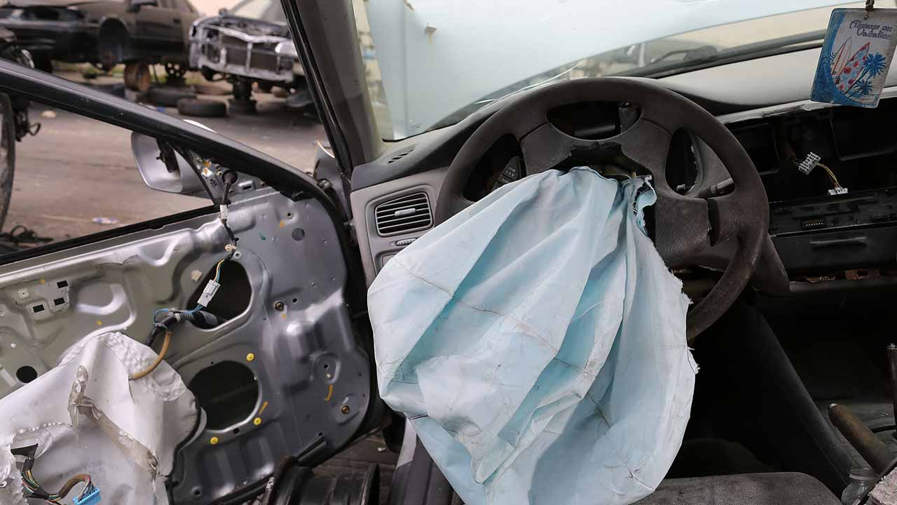 This file photo taken on May 22, 2015 shows a deployed airbag is seen in a 2001 Honda Accord at the LKQ Pick Your Part salvage yard on May 22, 2015 in Medley, Florida. Takata is close to settling a US criminal probe into the exploding airbag scandal, two people familiar with the matter said December 28, 2016. The Japanese auto parts supplier could reach a final agreement with the US Department of Justice before President-elect Donald Trump assumes office January 20, the sources told AFP, broadly confirming a report in the Wall Street Journal.  JOE RAEDLE / GETTY IMAGES NORTH AMERICA / AFP