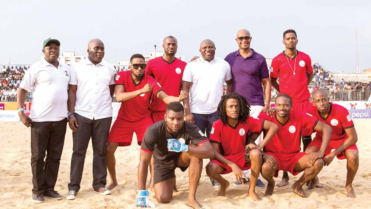 Governor Ambode (3rd right on back row), others pose with Team D'banj at the 2016 Copa Lagos.