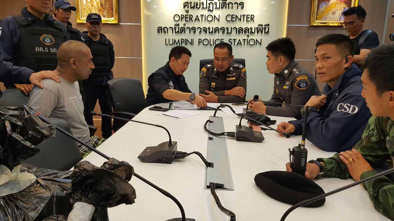 This handout received by the Royal Thai Police and taken on December 3, 2016 shows Abdul Rehman (L), a Pakistani national who was arrested in Bangkok on December 2 on suspicion of starting a devastating 2012 factory fire in Karachi killing 259 people, at Lumpini police station in Bangkok. STR / AFP Royal Thai Police / AFP