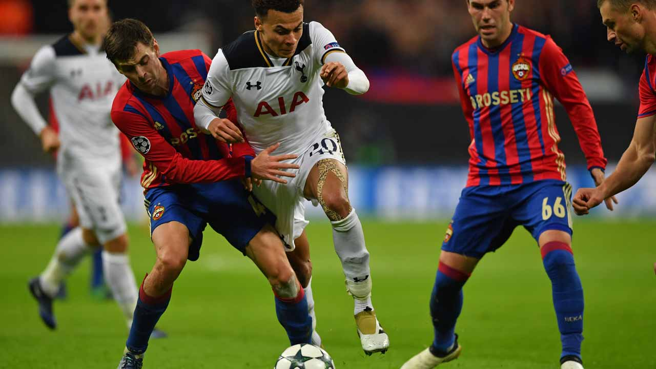 CSKA Moscow's Russian defender Georgi Schennikov (L) fouls Tottenham Hotspur's English midfielder Dele Alli during the UEFA Champions League group E football match between Tottenham Hotspur and CSKA Moscow at Wembley Stadium in north London on December 7, 2016.  Ben STANSALL / AFP