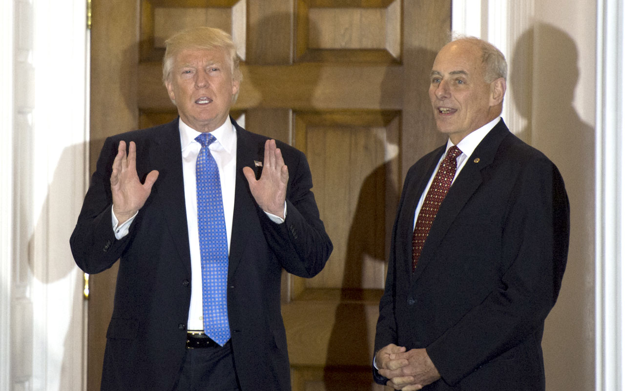 US President-elect Donald Trump meeting with retired Marine Corps general John Kelly at the clubhouse of Trump National Golf Club in Bedminster, New Jersey. President-elect Donald Trump has decided to name retired Marine Corps general John Kelly, a veteran of combat in Iraq, to lead the Department of Homeland Security, US media said December 7, 2016. Kelly would be the third retired general -- all of them former Marines -- to be named to cabinet-level positions in Trump's administration. The impending appointment was widely reported in the US media but not confirmed by Trump's transition office, apparently because Kelly is out of the country. Kelly, 66, is a former head of the US Southern Command and was the commanding general of Multi-National Force-West in Iraq from 2008 to 2009.  / AFP PHOTO / DON EMMERT