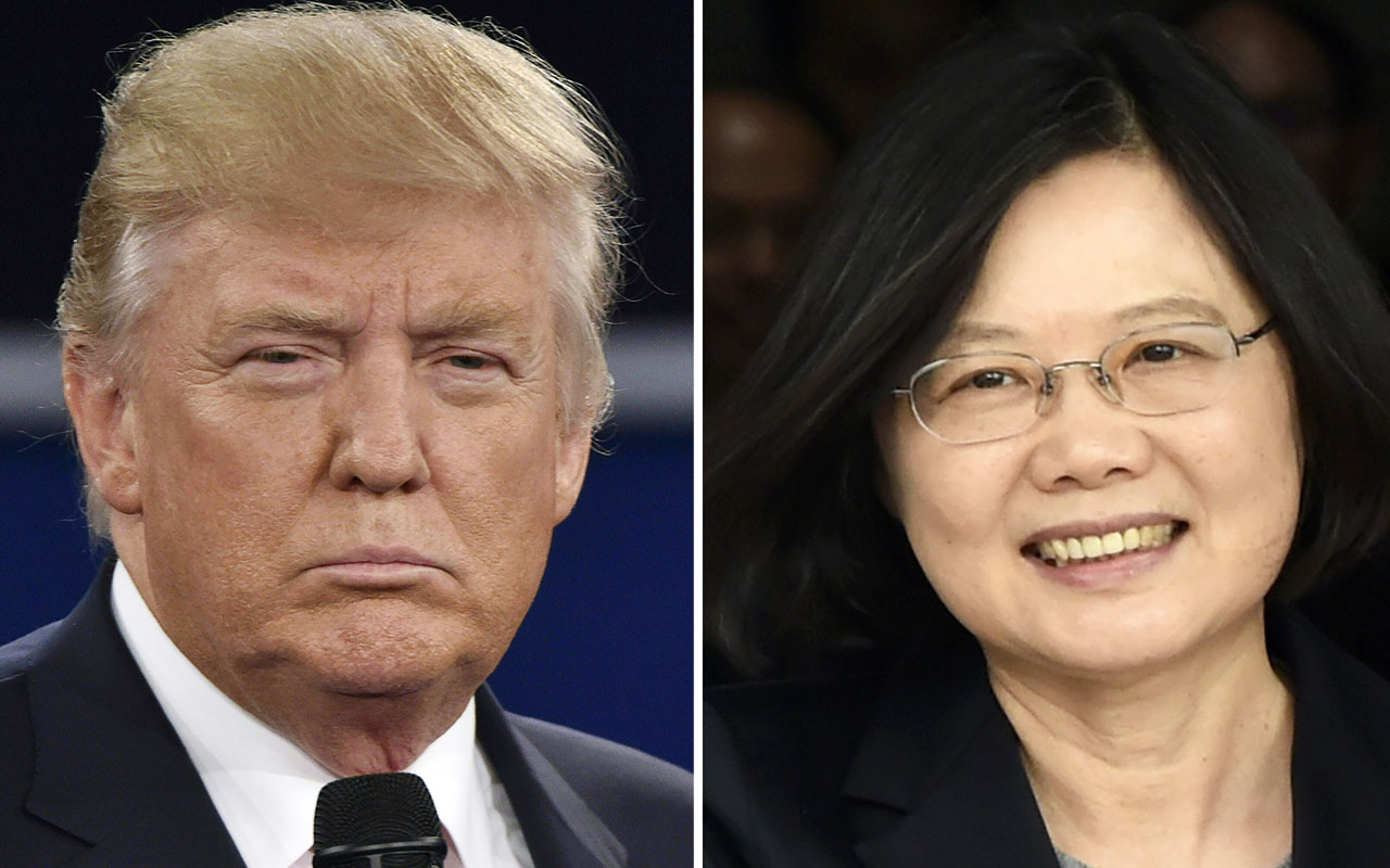 "(FILES) This file photo taken on December 03, 2016 shows (FILES) This combo of file photos shows Republican presidential candidate Donald Trump (L) in St. Louis, Missouri on October 9, 2016 and Taiwan's President Tsai Ing-wen in Panama City on June 27, 2016. President-elect Donald Trump's controversial telephone conversation with the leader of Taiwan was just a ""courtesy call,"" US Vice President-elect Mike Pence said December 4, 2016. ""It was nothing more than taking a courtesy call from a democratically elected leader,"" Pence told ABC News, speaking about the Friday call between Trump and Taiwan's Tsai Ing-wen, which broke decades of US diplomatic policy and risks creating a serious rift with China. / AFP PHOTO / STAFF"