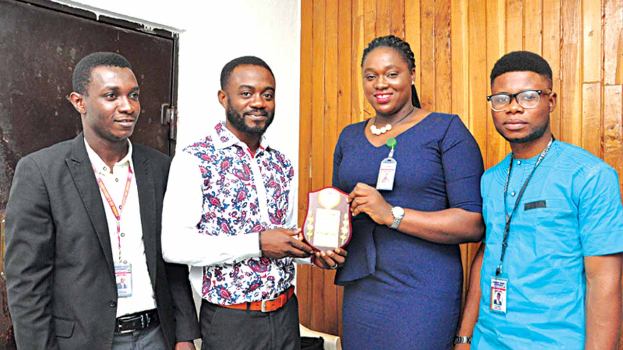 John Chukwujem Aigbogun, Attorney General, Student Union Government, UNIBEN (left); Mr. George Paul Osondu, Operations/Business Development Manager, Oracle Experience Ltd; Miss Lauretta Oyemwenosa Obakpolo, President, SUG, UNIBEN and Jatto John Ovie, Secretary General, SUG UNIBEN, at the official presentation of the Award of Recognition to Paul Osondu in Lagos.