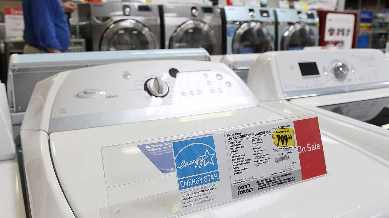 (FILES) This file photo taken on March 26, 2010 shows a new washing machine at a Best Buy store in Marin City, California. Chinese manufacturers are dumping washing machines into the US market at artificially low prices, making them subject to punitive duties of up to 52 percent, the Commerce Department announced on December 9, 2016. In a case brought by US appliance manufacturer Whirlpool a year ago, in a market that saw $1.1 billion imports in 2015, one Chinese firm was found to be dumping the large clothes washers at up to 52.5 percent below the fair price. JUSTIN SULLIVAN / GETTY IMAGES NORTH AMERICA / AFP
