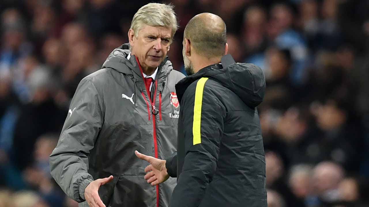 Arsenal's French manager Arsene Wenger (L) shakes hands with Manchester City's Spanish manager Pep Guardiola after the English Premier League football match between Manchester City and Arsenal at the Etihad Stadium in Manchester, north west England, on December 18, 2016. Manchester City won the game 2-1. Paul ELLIS / AFP