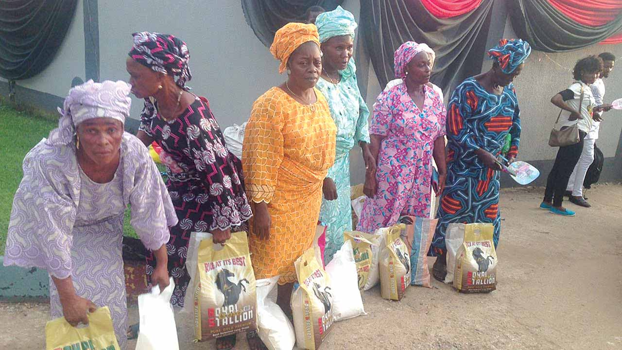 Some of the widows with their bags of rice