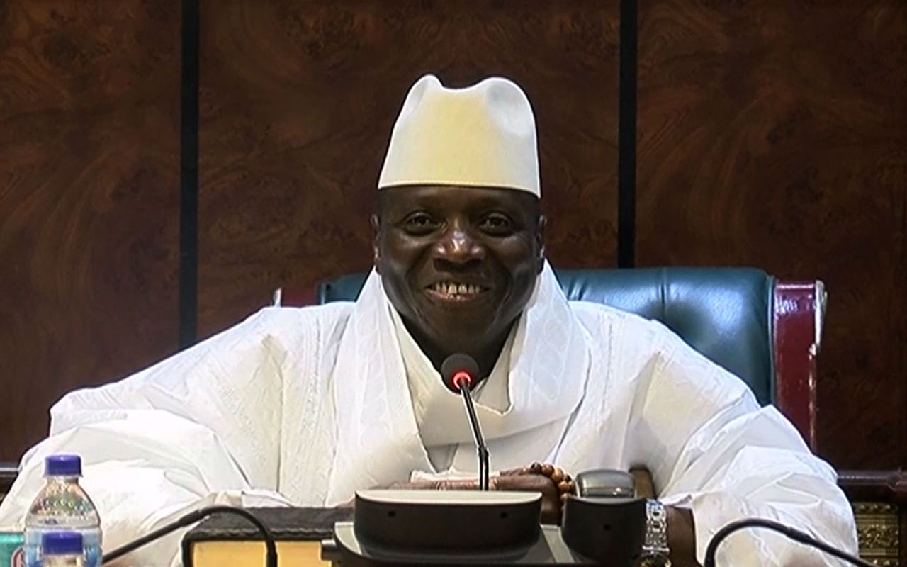 "An image grab taken on December 3, 2016 from a video of the Gambia and Television Services (GRTS) broadcasted on December 2, 2016, in Banjul shows outgoing Gambian President Yahya Jammeh speaking during a press conference after being defeated during the presidential election. Jammeh conceded defeat to opposition leader Adama Barrow on December 2, 2016 accepting that Gambians had ""decided that I should take the backseat"". The Gambia's President-elect Adama Barrow was to hold talks with his coalition the day after to plot his transition to power, following a shock election victory that ended the 22-year rule of Yahya Jammeh. / AFP PHOTO / GRTS - Gambia Radio and Television Services / Handout"