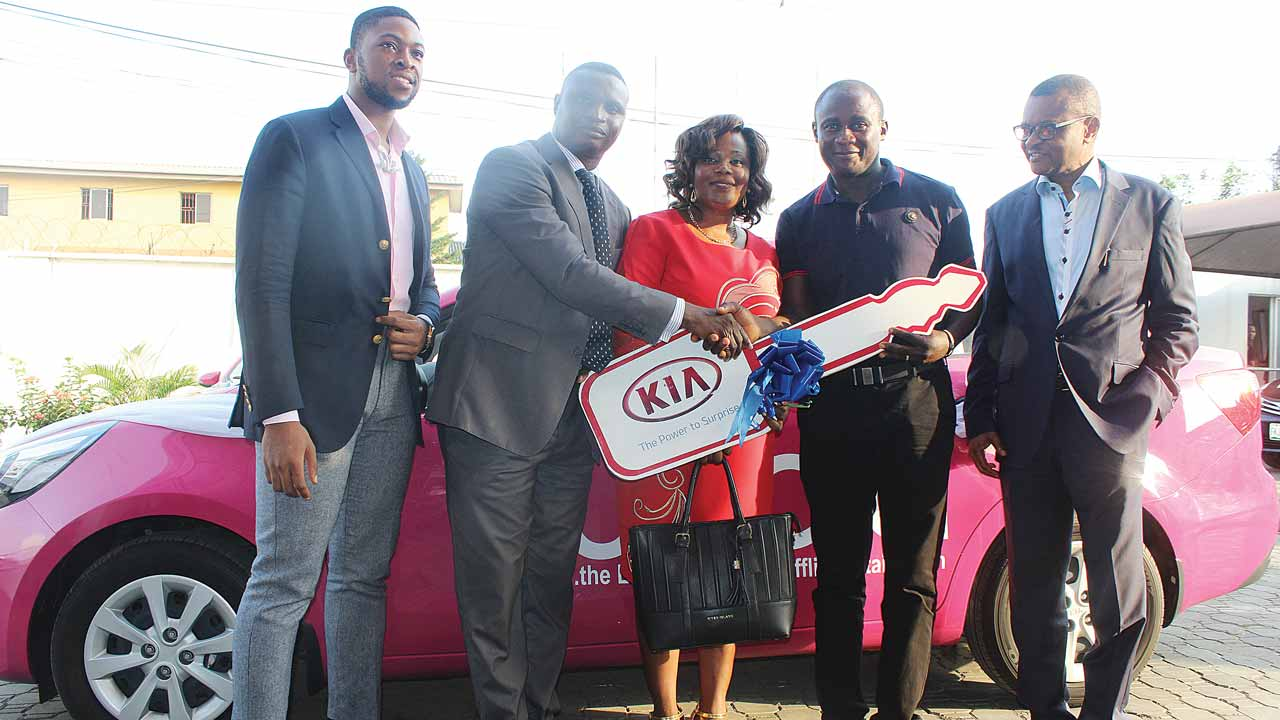 Founder/Vice President, Yudala, Prince Nnamdi Ekeh (left); Kia Motors representative, Moses Oguntimehin; Wife of the winner, Jummai Uadiala; Winner of the Kia Rio, Samuel Uadiala and Chief Executive Officer, Yudala, Dave Ibelegbu at the end of the Yudala Zero Gravity Concert and Black Friday Sales, where Uadiala emerged the lucky winner of the grand prize in a raffle draw in Lagos.