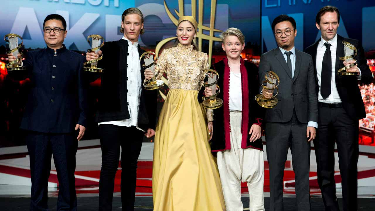 (From L) Chinese director Zang Donor, Icelandic actor Blaer Hinriksson, Afghan actress Fereshteh Hosseini, Danish actor Baldur Einarsson, Chinese producer Wang Zijian and Austrian director Rainer Frimmel pose for a picture with they trophies during the 14th edition of the Marrakech International Film festival, on December 10, 2016 in Marrakech. FADEL SENNA / AFP