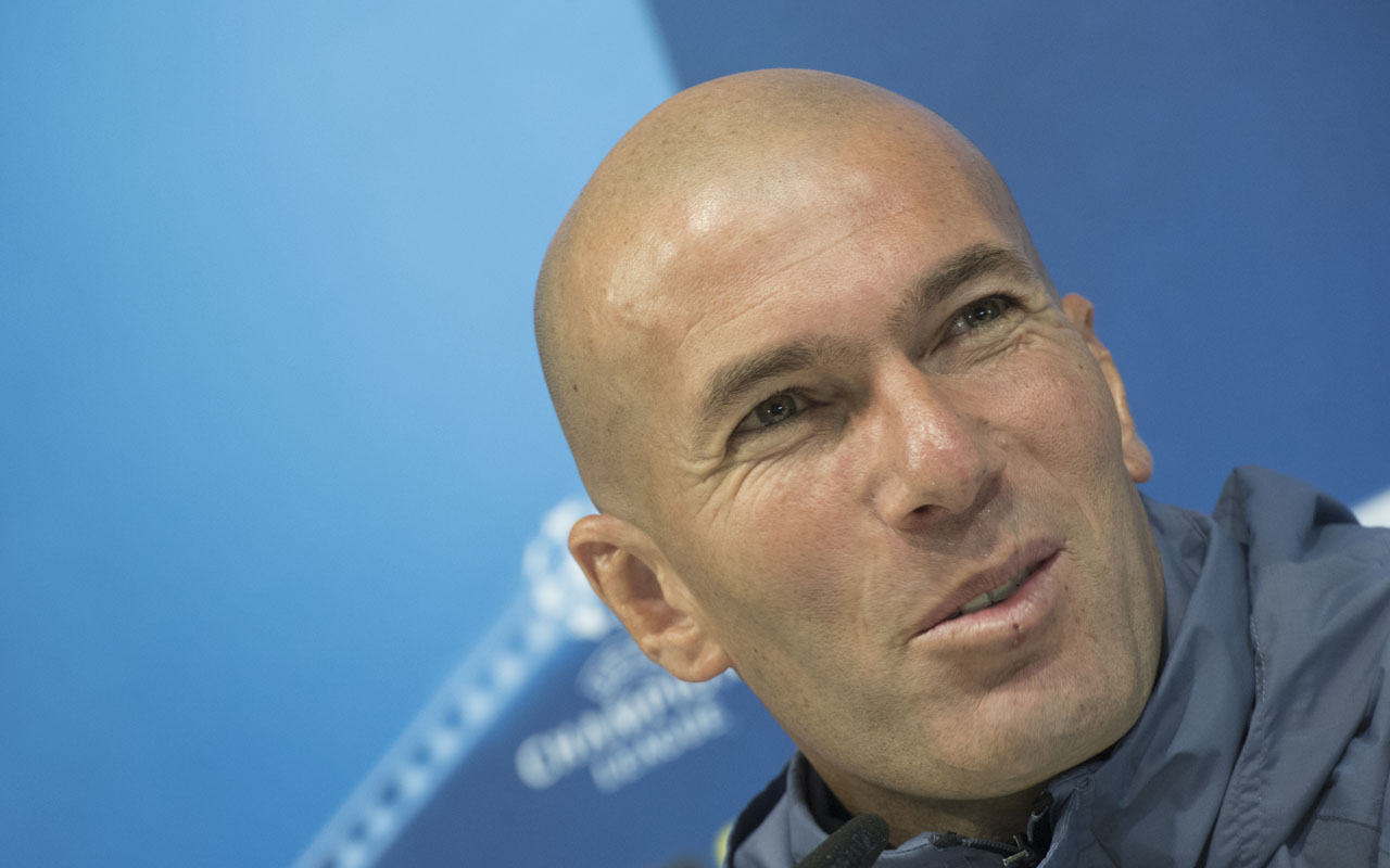 Real Madrid's French coach Zinedine Zidane gives a press conference on the eve of the UEFA Champions league football match Real Madrid vs Borussia Dortmund at the Real Madrid's training ground of Valdebebas in Madrid on December 6, 2016 / AFP PHOTO / CURTO DE LA TORRE