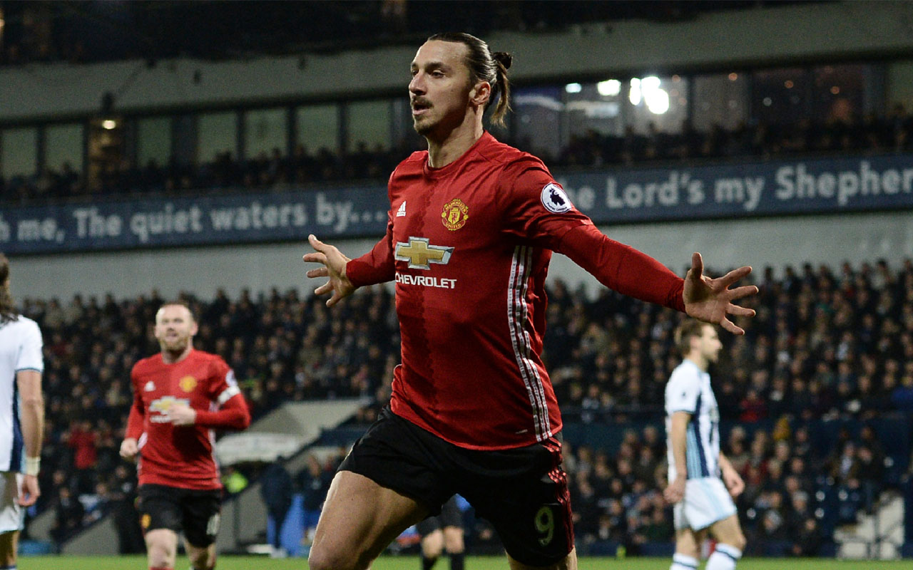 Manchester United's Swedish striker Zlatan Ibrahimovic celebrates after scoring the opening goal of the English Premier League football match between West Bromwich Albion and Manchester United at The Hawthorns stadium in West Bromwich, central England, on December 17, 2016. / AFP PHOTO / Oli SCARFF /