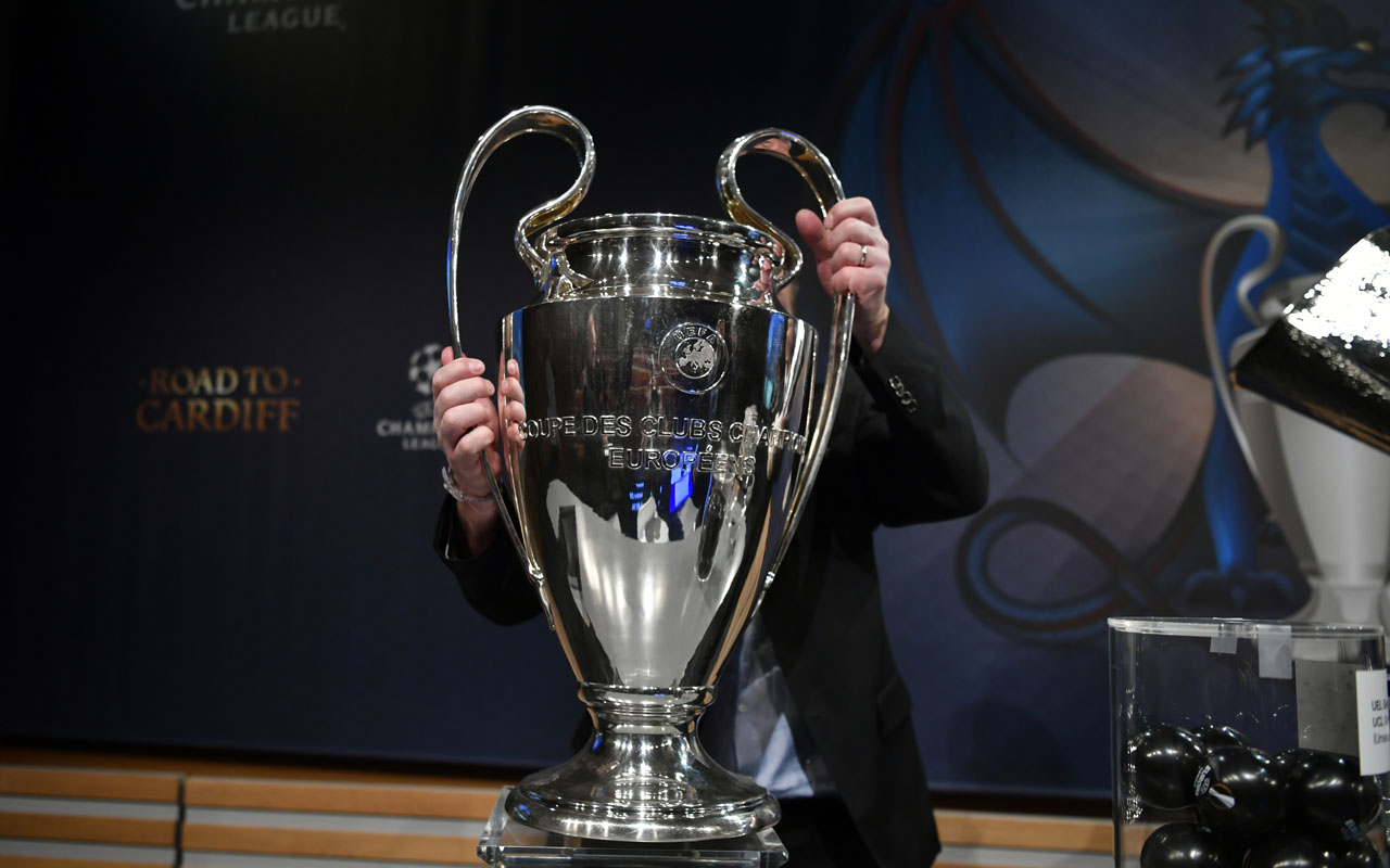 The UEFA Champions League trophy is taken away after the draw for the round of 16 of the UEFA Champions League football tournament at the UEFA headquarters in Nyon on December 12, 2016. / AFP PHOTO / Fabrice COFFRINI