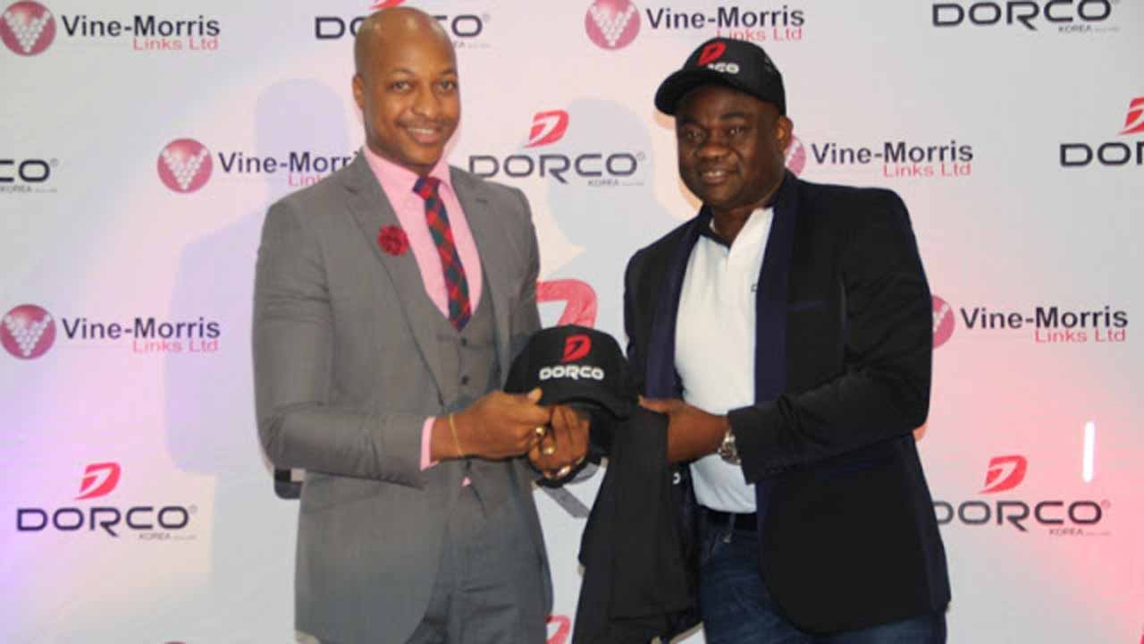 Ogbonna (left) with representative of Dorco at the signing ceremony.