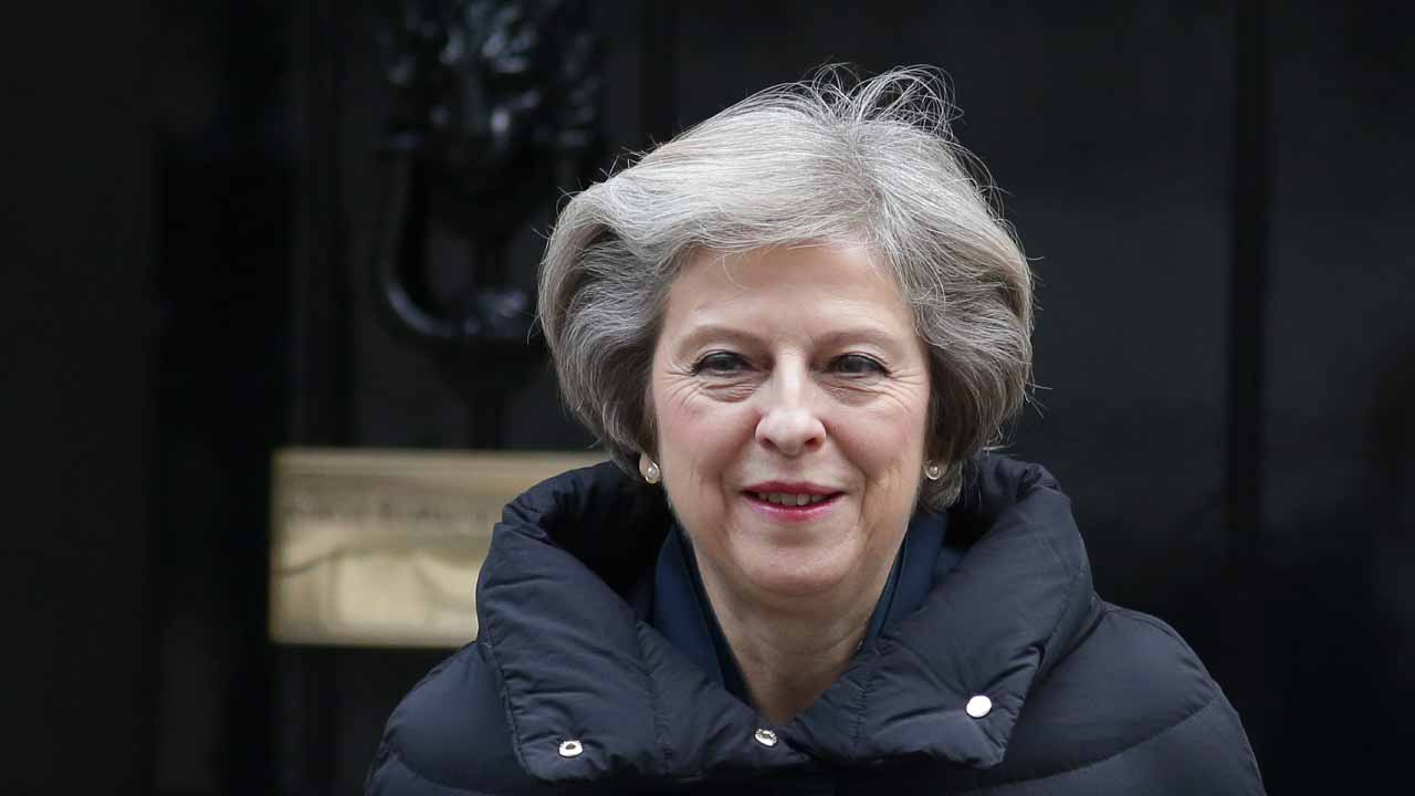 British Prime Minister Theresa May leaves 10 Downing Street in central London on January 11, 2017 to attend the weekly Prime Ministers Questions session in the House of Commons. PHOTO: Daniel LEAL-OLIVAS / AFP