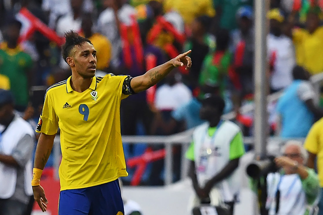 Gabon's forward Pierre-Emerick Aubameyang celebrates after scoring a goal during the 2017 Africa Cup of Nations group A football match between Gabon and Guinea-Bissau at the Stade de l'Amitie Sino-Gabonaise in Libreville on January 14, 2017. / AFP PHOTO / GABRIEL BOUYS