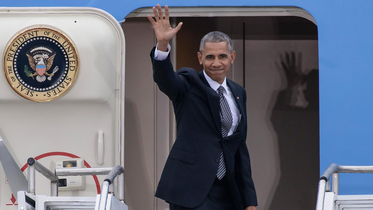 "(FILES) This file photo taken on November 18, 2016 shows US President Barack Obama waving as he enters his plane ""Air Force One"" prior to his departure from the Tegel airport in Berlin, where the US President met the German Chancellor and other European leaders. US President Barack Obama and German Chancellor Angela Merkel may have got off to a rocky start but his impending departure has sparked a wave of nostalgia and trepidation in Berlin. As Donald Trump threatens to upend the pillars of the postwar order, few cities have historically symbolised the strength of the transatlantic bond more than the reunified German capital, where Obama held the biggest rally of his 2008 watershed campaign. PHOTO: CLEMENS BILAN / AFP"