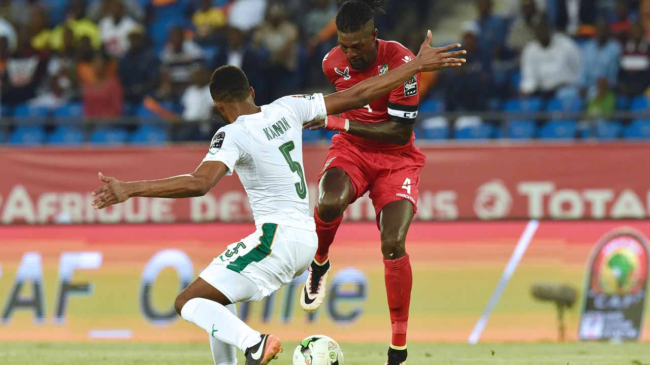 Ivory Coast's defender Wilfried Kanon (L) challenges Togo's forward Emmanuel Adebayor during the 2017 Africa Cup of Nations group C football match between Ivory Coast and Togo in Oyem on January 16, 2017. PHOTO: ISSOUF SANOGO / AFP