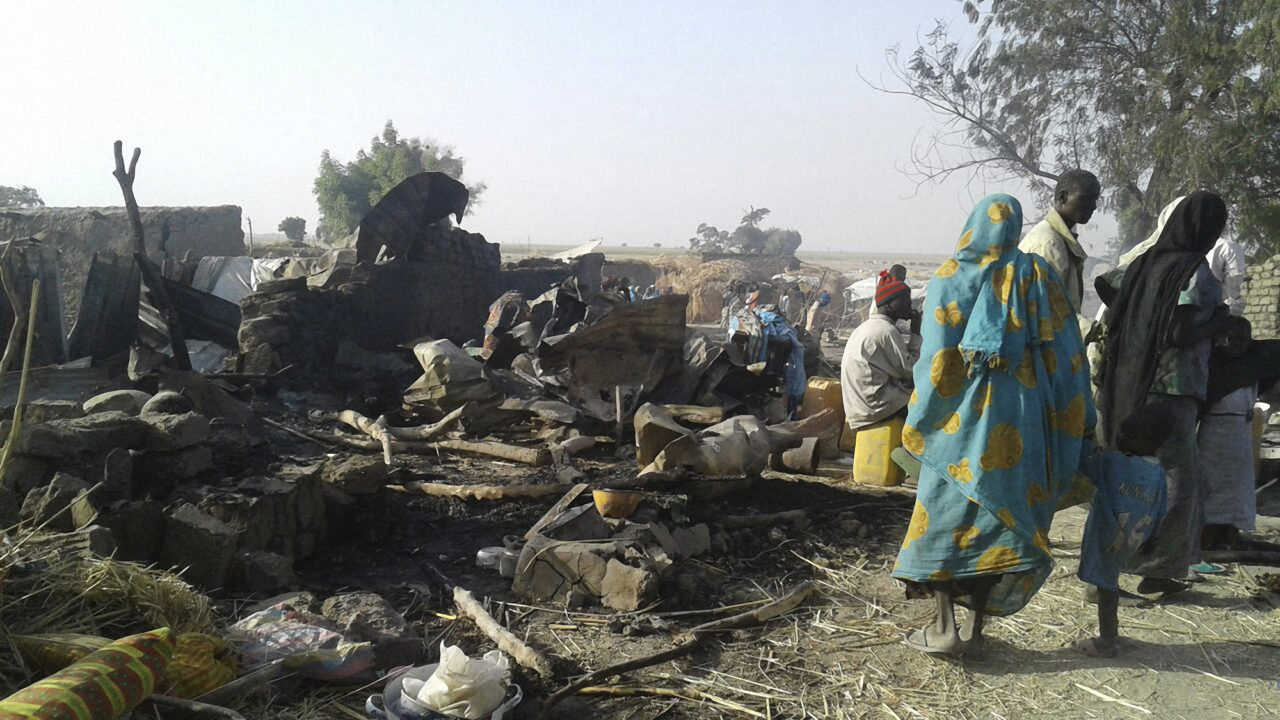 "This handout image received courtesy of Doctors Without Border (MSF) on January 17, 2017, shows people standing next to destruction after an air force jet accidentally bombarded a camp for those displaced by Boko Haram Islamists, in Rann, northeast Nigeria. At least 52 aid workers and civilians were killed on January 17, 2017, when an air force jet accidentally bombed a camp in northeast Nigeria instead of Boko Haram militants, medical charity MSF said. / AFP PHOTO / Médecins sans Frontières (MSF) / Handout / RESTRICTED TO EDITORIAL USE - MANDATORY CREDIT ""AFP PHOTO / DOCTORS WITHOUT BORDERS (MSF)"" - NO MARKETING NO ADVERTISING CAMPAIGNS - DISTRIBUTED AS A SERVICE TO CLIENTS"