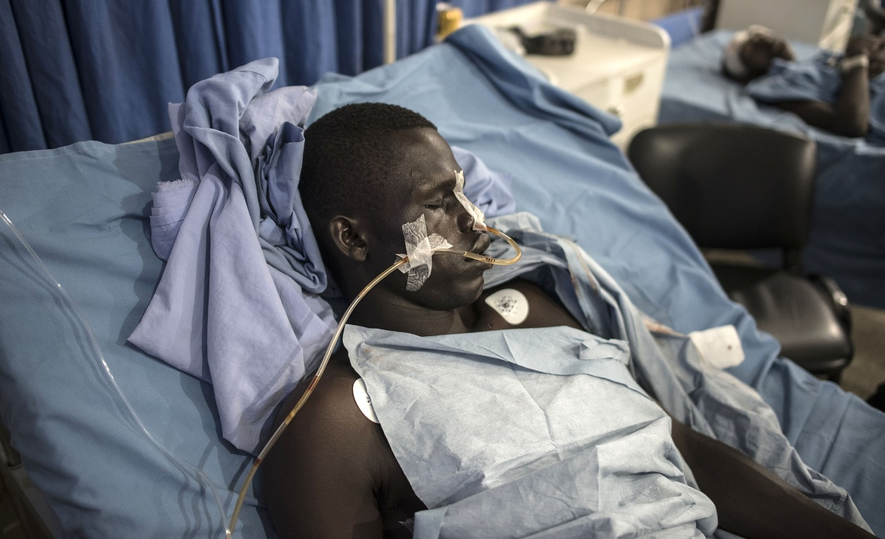 An man injured during the accidental airstrike recovers in the Men's Ward at the Maiduguri State Specialist Hospital on January 18, 2017. At least 70 people have died in an Internally Displace Camp in Borno State from an accidental military airstrike on January 17, 2017, intended to target Boko Haram militants in Rann, in north-eastern Nigeria. / AFP PHOTO / STEFAN HEUNIS