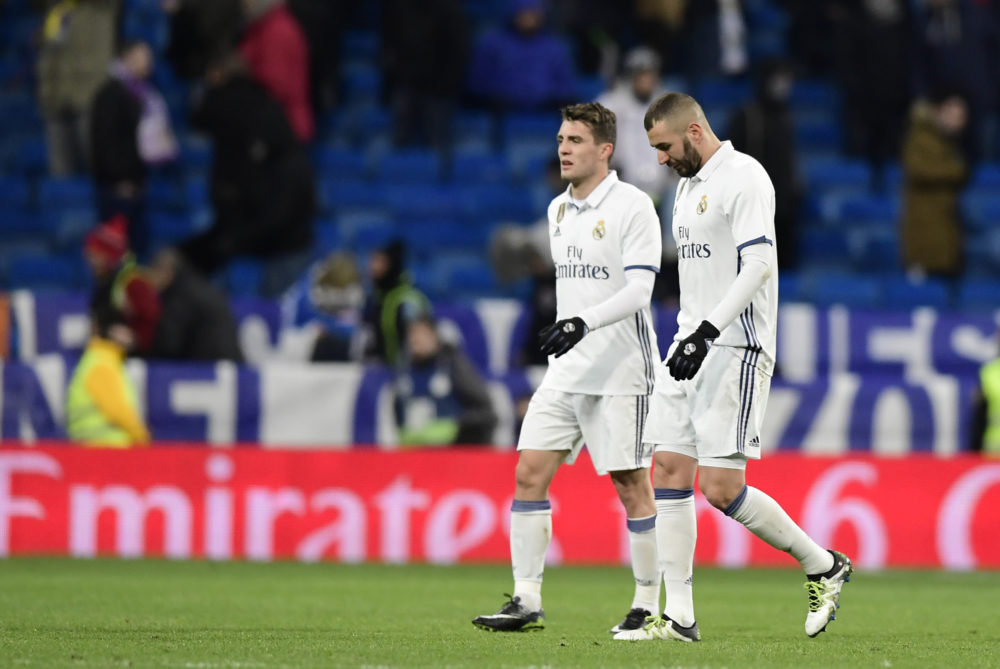 Real Madrid's French forward Karim Benzema (R) and Real Madrid's Croatian midfielder Mateo Kovacic leave the pitch at the end of the Spanish Copa del Rey (King's Cup) quarter-final first leg football match Real Madrid CF vs RC Celta de Vigo at the Santiago Bernabeu stadium in Madrid on January 18, 2017. Celta won 2-1. / AFP PHOTO / JAVIER SORIANO