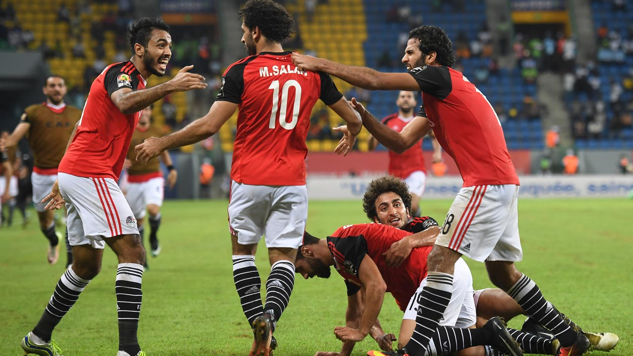 Egypt's players celebrate a goal during the 2017 Africa Cup of Nations group D football match between Egypt and Uganda in Port-Gentil on January 21, 2017.  Justin TALLIS / AFP