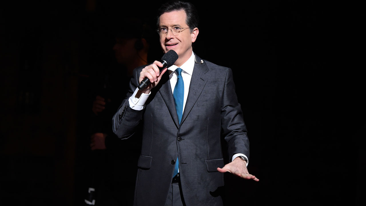 "This February 15, 2016 photo shows TV Host, comedian Stephen Colbert speaking on stage prior to ""Hamilton"" GRAMMY performance for The 58th GRAMMY Awards at Richard Rodgers Theater in New York City. Late night talk show host Stephen Colbert will host the 69th Primetime Emmy Awards in September, organizers announced on Monday Theo Wargo / AFP"