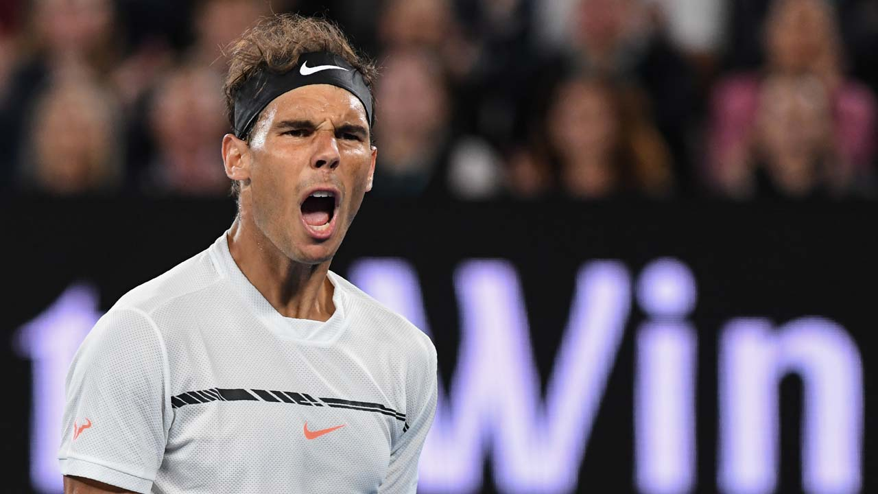 Spain's Rafael Nadal reacts after a point against Canada's Milos Raonic during their men's singles quarter-final match on day ten of the Australian Open tennis tournament in Melbourne on January 25, 2017. SAEED KHAN / AFP